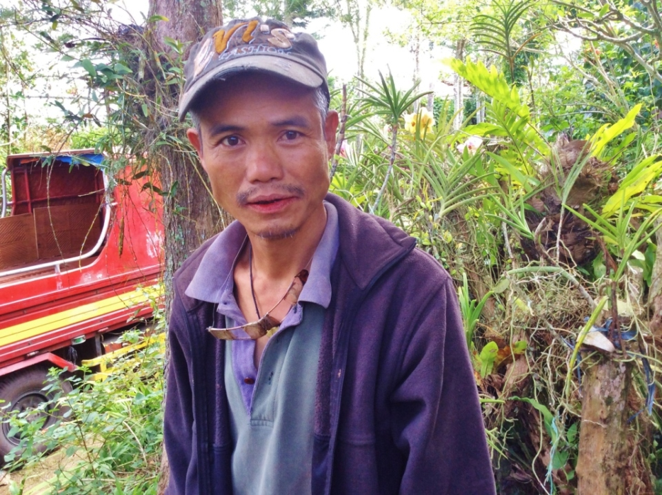 Delfin, the maestro. He is a jolly Ifugao who spins jokes and spits the nganga around the area where the native house was being built.